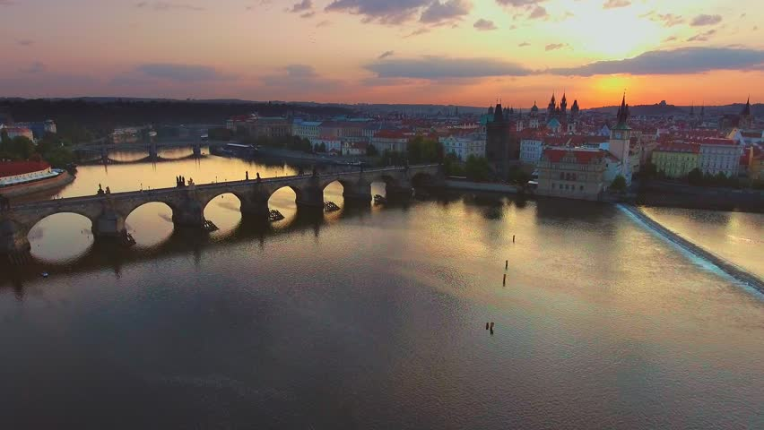 4K 3840x2160 Aerial sunrise video footage of world famous destination place - old architecture of Charles bridge (Karluv most) over Vltava river in Prague city, capital of Czech Republic, Europe