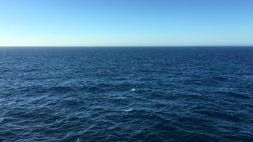 Beautiful deep blue sea water on a clear day #1016089255