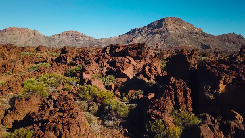 Aerial view of the Teide National Park, flight over the mountains and hardened lava. Tenerife, Canary Islands