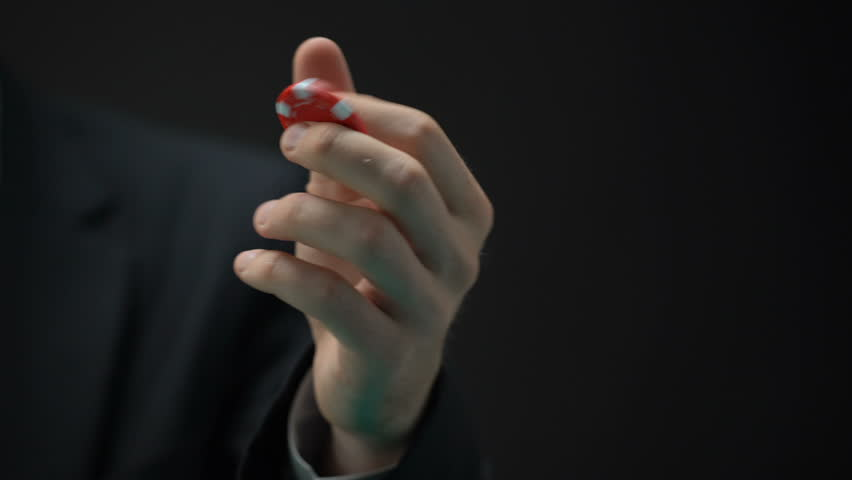 Businessman hand tossing casino chip, tycoon making risky investment decision | Shutterstock HD Video #1016162125