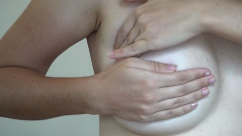 Breast Cancer Prevention. Woman Self Examining Chest on Mastopathy Symptoms