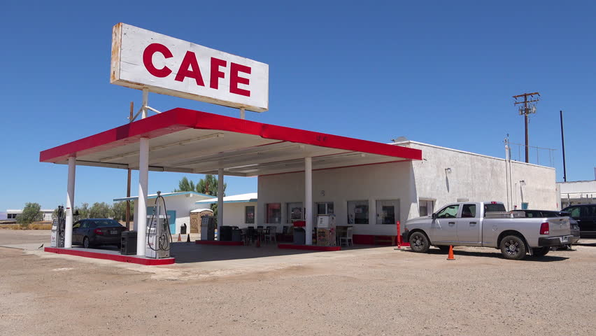 CIRCA 2018 - Establishing shot of a lonely desert gas station and hotel motel cafe in the Mojave Desert.