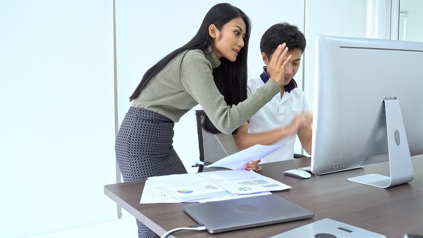 Small team meeting. Asian man sitting with asian woman discussing about work with computer. Diverse business team start ups concept. | Shutterstock HD Video #1016257915