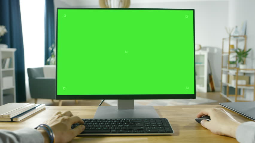 First Person View of Professional Freelancer Working on Green Mockup Screen Personal Computer From Home.  Shot on RED EPIC-W 8K Helium Cinema Camera. | Shutterstock HD Video #1016262025
