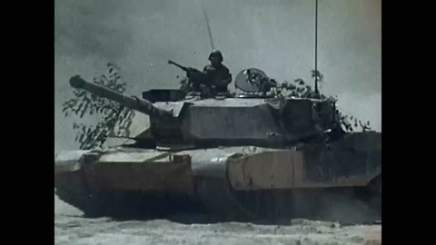CIRCA 1980S - An attack helicopter is flown and an M1 Abrams battle tank is shown as well as an Bradley Fighting Vehicle.