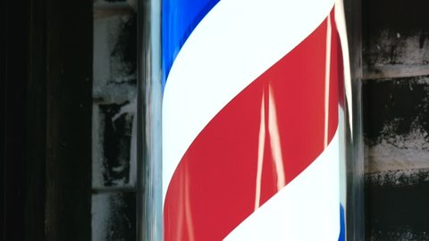 Motion Of Barbershop Pole Spinning At Barber Shop outdoors