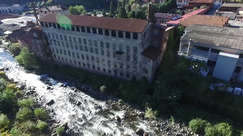 flight on the stream near the industrial building of the beginning of the century italy