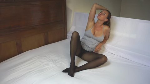 photo shoot model posing on bed in pantyhose