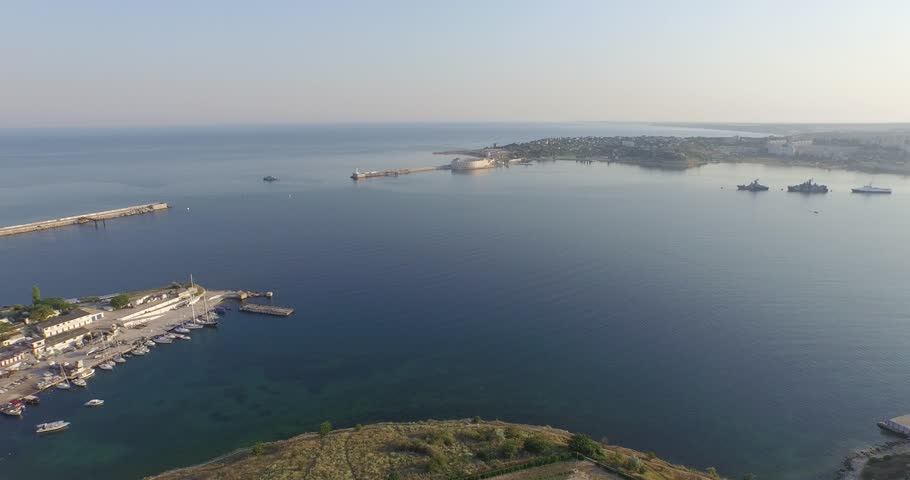 Shooting from the air of  Sevastopol bay, warships in the roads, Russian Navy Day 2015 | Shutterstock HD Video #1016330425