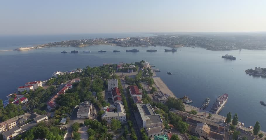 Shooting from the air of  Sevastopol bay, warships in the roads, Russian Navy Day 2015 | Shutterstock HD Video #1016331205