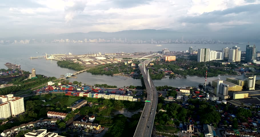 Aerial morning view of traffic near Prai River Bridge. Is a dual-three lane cable stayed bridge connecting the banks of the Prai River in Prai, Penang, Malaysia. | Shutterstock HD Video #1016367625