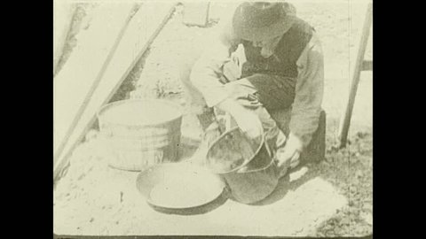 1930s: Man pours dust into bowl and sifts with water. Man pours liquid into bucket. Text describes purpose of reservoirs.