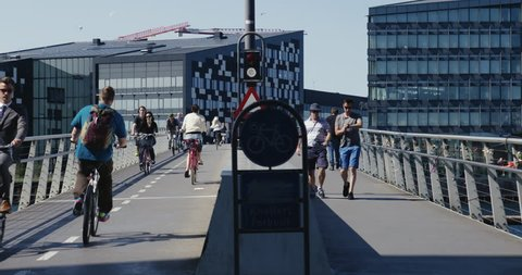 Copenhagen, Denmark - 23 August 2017: Bicycles and people walking on a bridge on a beautiful summer day