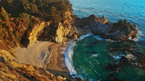 McWay Falls / 80-foot-tall (24 m) waterfall on the coast of Big Sur in central California that flows year-round from McWay Creek in Julia Pfeiffer Burns State Park