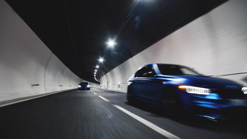 Ponte Fella/Italy-05.02.2018:Rolling tracking vehicle shot of three super cars driving in a tunnel at night Lamborghini Bmw