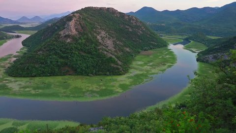 Spectacular view of Canyon of Rijeka Crnojevica river, Skadar lake lacation. Impressive summer sunset in Montenegro countryside. Full HD video (High Definition).