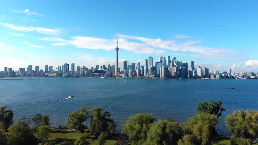 Aerial view of Toronto skyline including Centre Island and Lake Ontario on a summer day in Toronto, Ontario, Canada. | Shutterstock HD Video #1016465935