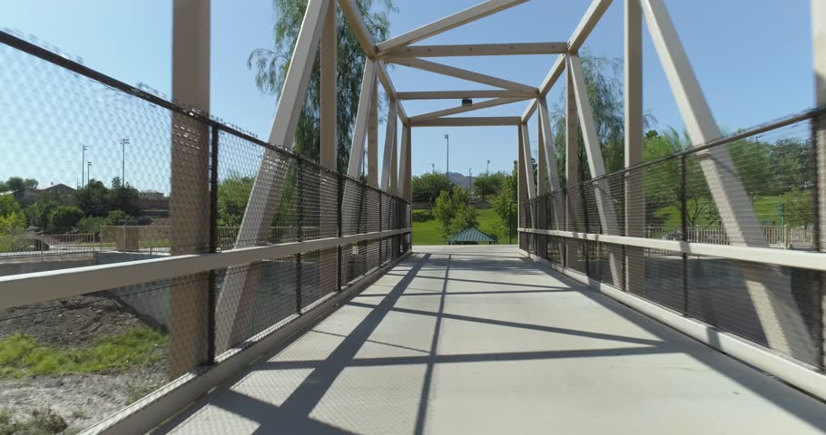 Aerial Drone Shot Flying Along Pedestrian Foot Bridge And Up Over Park In Henderson Nevada | Shutterstock HD Video #1016482165