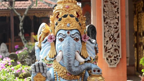From up to down footage of beautiful blue Ganesha, located in Ubud, Bali, Indonesia
