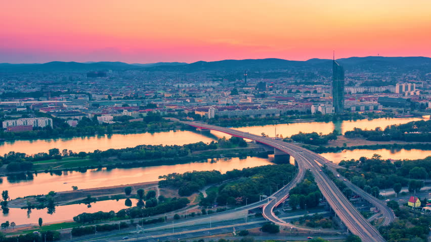 Vienna, Austria cityscape with skyline and with a Danube panorama at sunset. Time lapse. Zoom out effect | Shutterstock HD Video #1016521975