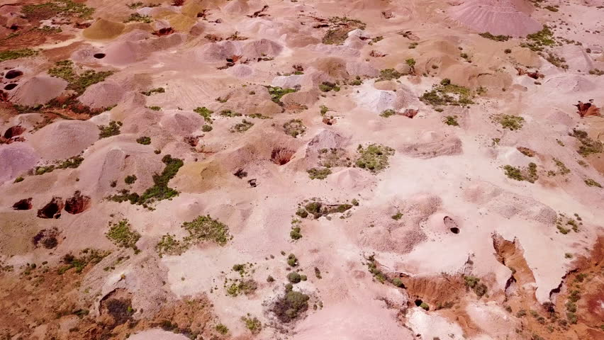 AUSTRALIA - CIRCA 2010s - Aerial drone shot of opal mines and mining tailings in the desert outback of Coober Pedy Australia.