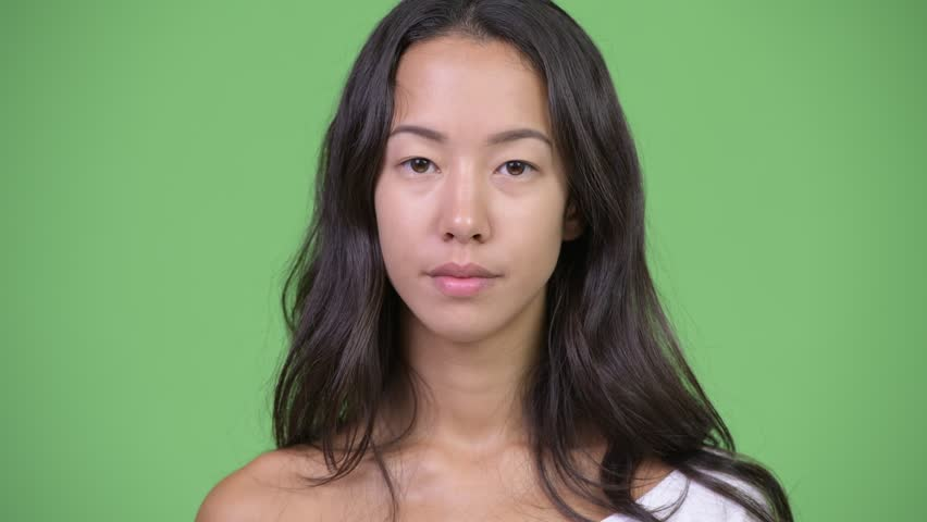 Young happy beautiful multi-ethnic woman smiling with finger on lips | Shutterstock HD Video #1016555395