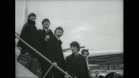 CIRCA 1964 - The Beatles are surrounded by screaming fans when they arrive at JFK, and as they tour Central Park.