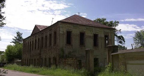 4K summer day video of old ruined overgrown mansions and estates in center of small vintage town Torzhok in Tver Oblast, half way between Moscow and Saint Petersburg, in Russia