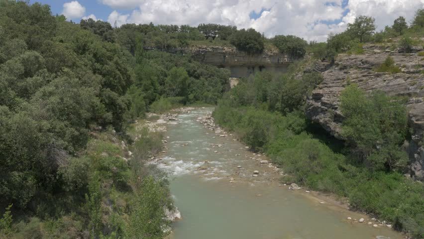 River At Barranco De Ramillar, Pyrenees, Spain - native version. Native 4:2:2, 10 Bit Material, straight out of the cam, watch also for a graded and stabilized version. | Shutterstock HD Video #1016583475