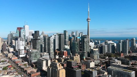 Toronto, Ontario, Canada, aerial view of Toronto cityscape showing Downtown buildings and architectural landmark CN Tower on a sunny day.