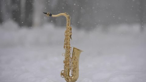 Christmas saxophone and falling snow