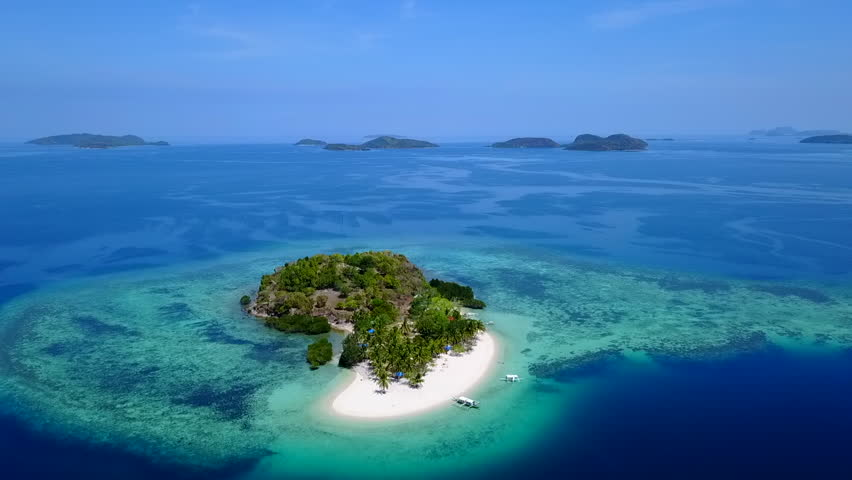 Aerial Tilt Down of a Small Private Tropical Island in the Philippines   Shutterstock HD Video #1016609125