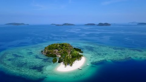 Aerial Tilt Down of a Small Private Tropical Island in the Philippines