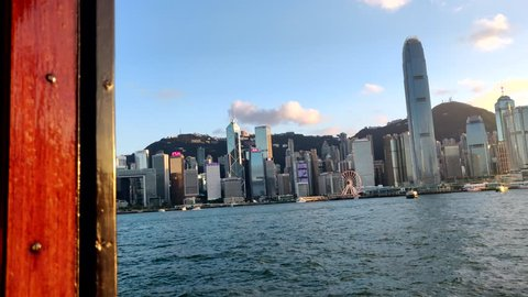 Inside a star ferry looking at Hong Kong Island and IFC during golden hour in Victoria Harbor, Hong Kong