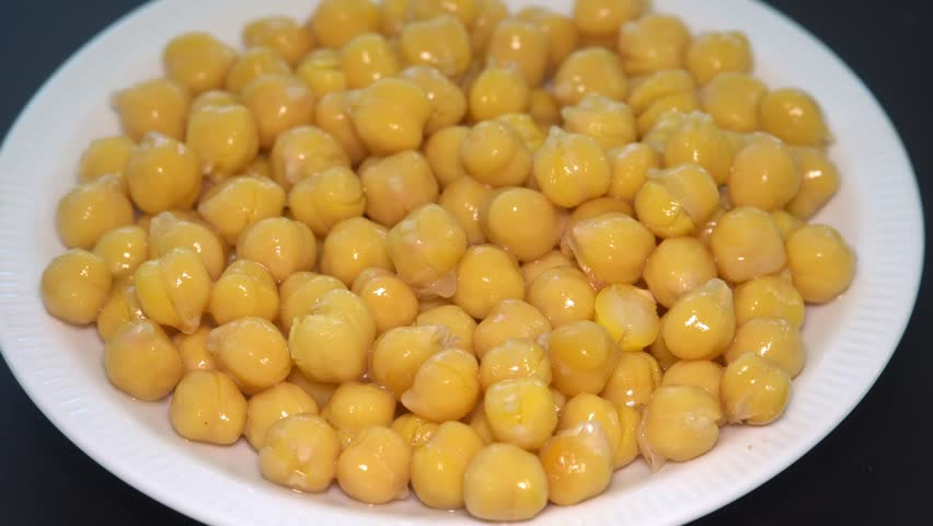 Chickpeas Rotating in White Bowl