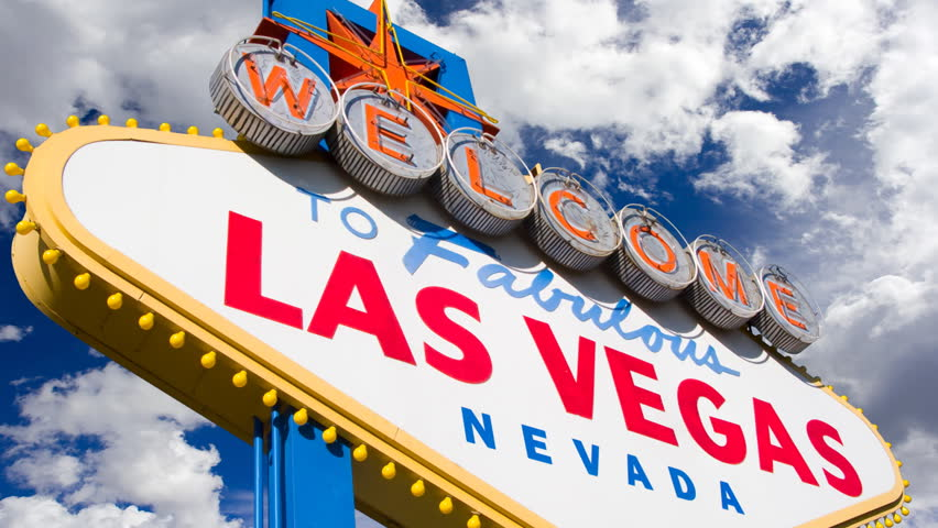 Welcome to Las Vegas, street sign in blue sky with time lapse clouds. HD Version