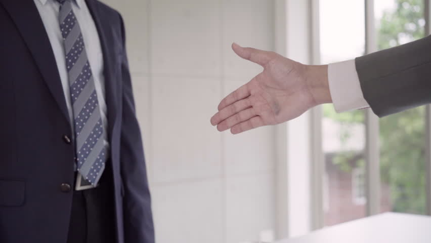 Slow motion - Handshake to seal a deal after a job recruitment meeting. Two asian confident businessman shaking hands during a meeting in the office, success, dealing, greeting and partner concept. | Shutterstock HD Video #1016796595