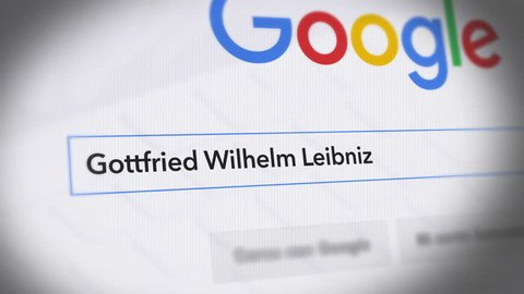 USA-Popular searches in 2018 Google Search Engine - Search For Gottfried Wilhelm Leibniz - Monitor with reflection hands typing a search on google