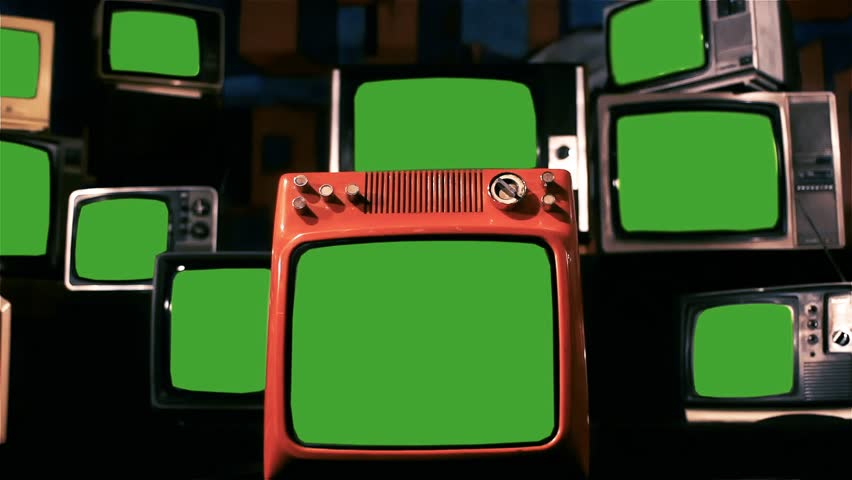"Many Old Tvs With Green Screen. Blue Steel Tone.  Zoom In. Ready to Replace Green Screens with Any Footage or Picture you Want. You Can Do it With ""Keying"" Effect. Full HD. 