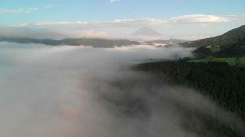 Flying above the clouds at lake Ashi and looking at mount Fuji, Hakone, Japan