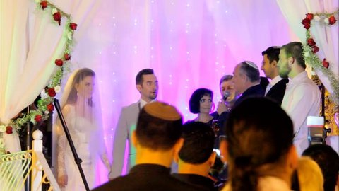 Tel Aviv, Israel - June 29, 2016: Jewish traditions wedding ceremony under chuppah