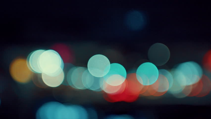 Moving Colorful blurred bokeh of car headlights in a highway