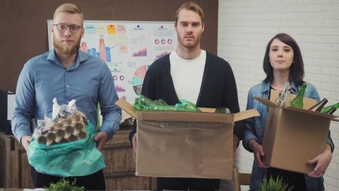 Portrait of business people in the office with recycling materials