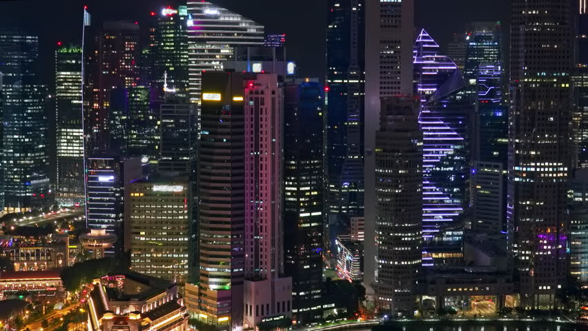 Beautiful night cityscape with Marina Bay Financial Centre buildings. Skyscrapers with light in windows. Futuristic view of downtown of modern Asian megalopolis in evening. | Shutterstock HD Video #1017010045