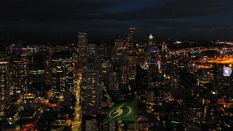 SEATTLE, WASHINGTON, USA - SEPTEMBER 15, 2018: Aerial video Seattle Space Needle tower and downtown skyline
