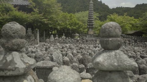 Wide shot of statues of Buddha in Adashino Nenbutsu-ji Temple, Kyoto, Japan