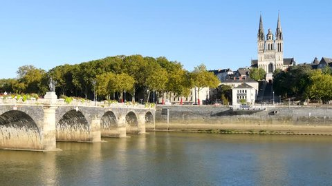 The Verdun bridge in Angers (France) is a bridge with masonry vaults. It is the oldest passage from one side of the Maine river to the other. In the background, there is the Cathedral of Angers.