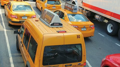New York, United States - jun 22, 2016: Tourists photograph views of New York from tourist bus. Row of yellow New York City taxi cabs. Overhead view of traffic at a standstill in a New York street .