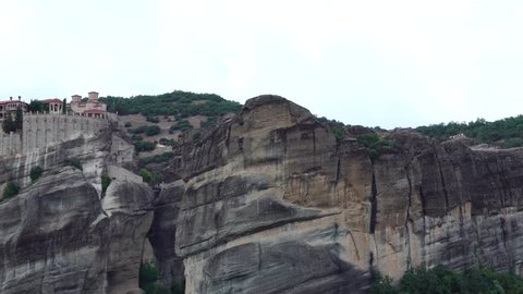 Grand Meteoron monastery on stone rock Pindus mountain range in Meteora Thessaly Greece in amazing panoramic landscape