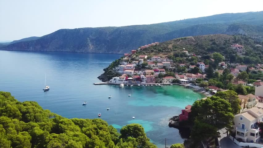 Aerial drone bird's eye view video of beautiful and picturesque colourful traditional fishing village of Assos in island of Cefalonia, Ionian, Greece #1017196825